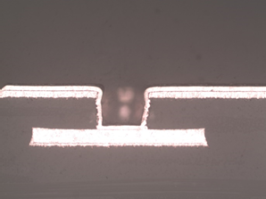 Laser drilled microvia